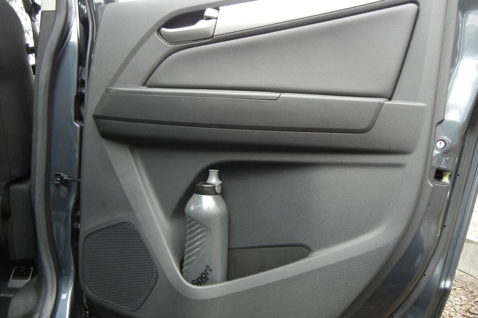 Rear seat passengers only get a bottle holder and small storage bin in each rear door. (image: Mark Oastler)