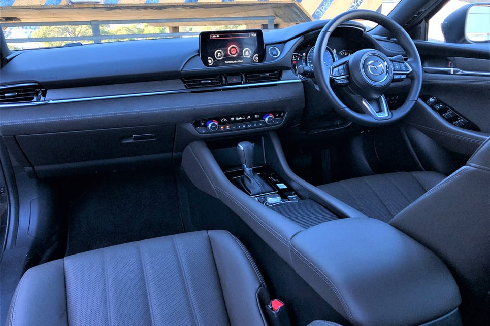 If there are any criticisms it's that the cabin is feeling dated compared to the cockpit of the new-generation Mazda3. (image: Richard Berry)