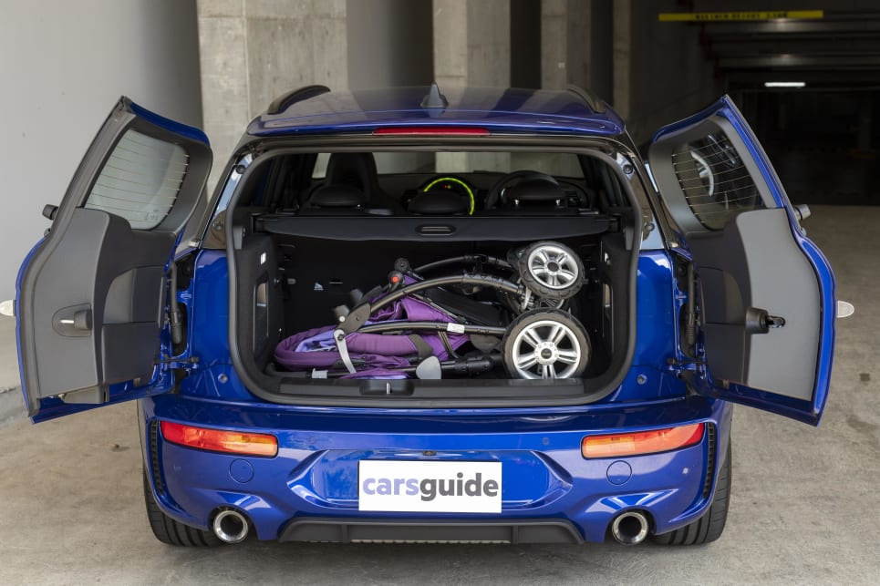 A pram fits snug in the boot of the Clubman.