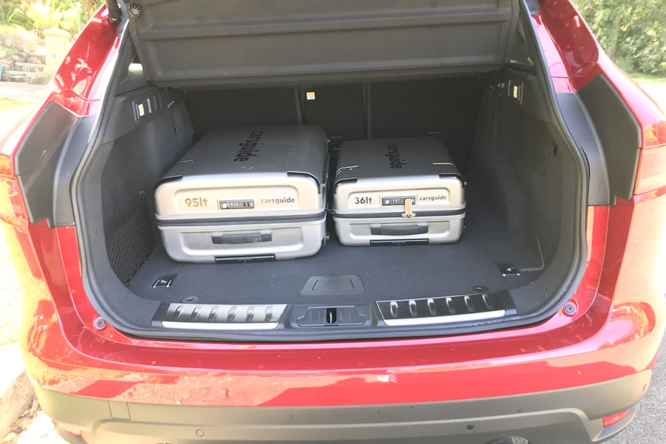The F-Pace's boot easily swallowed the CarsGuide suitcases.
