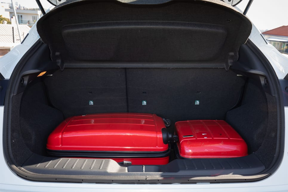 The cargo capacity is big enough to comfortably fit two suitcases.