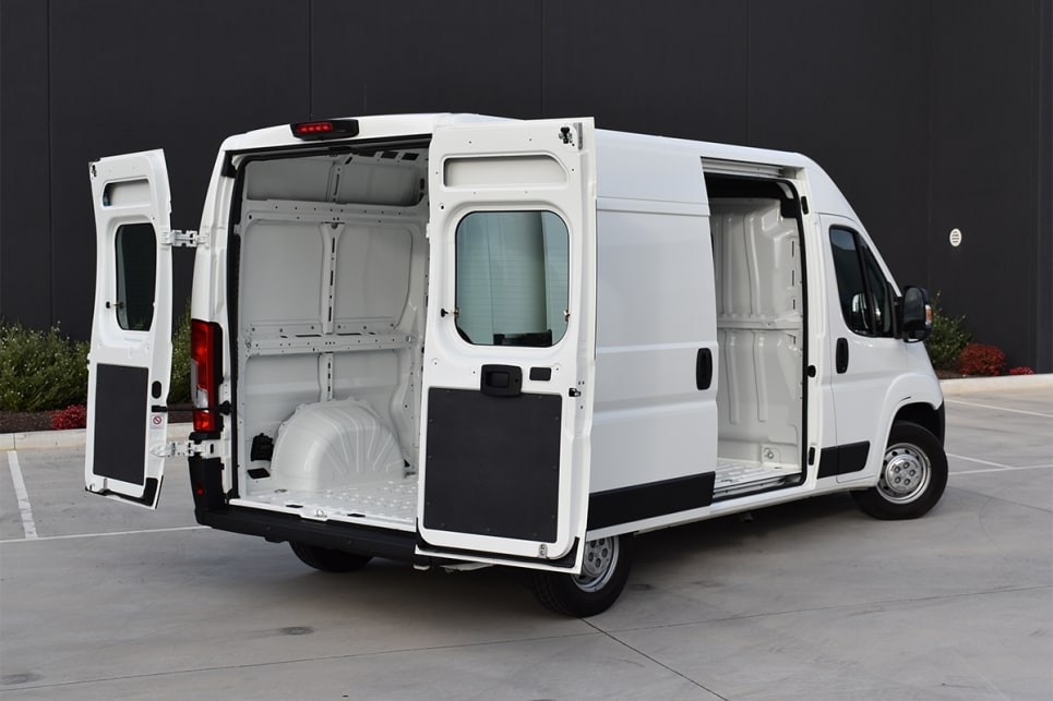 The cargo area can be accessed by rear barn-doors or side sliding side doors.