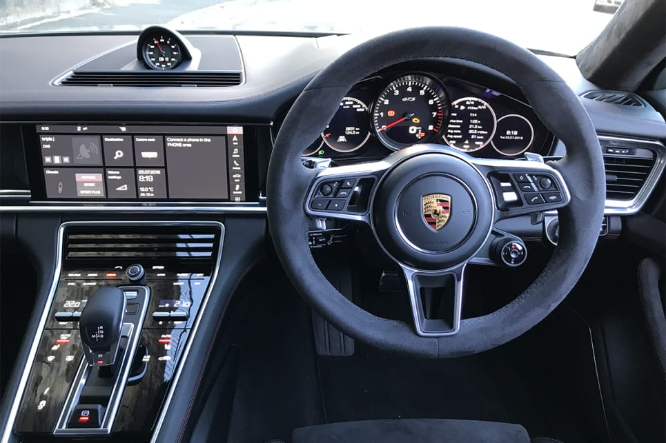The cabin has a strong hint of 911, especially the instrument cluster.