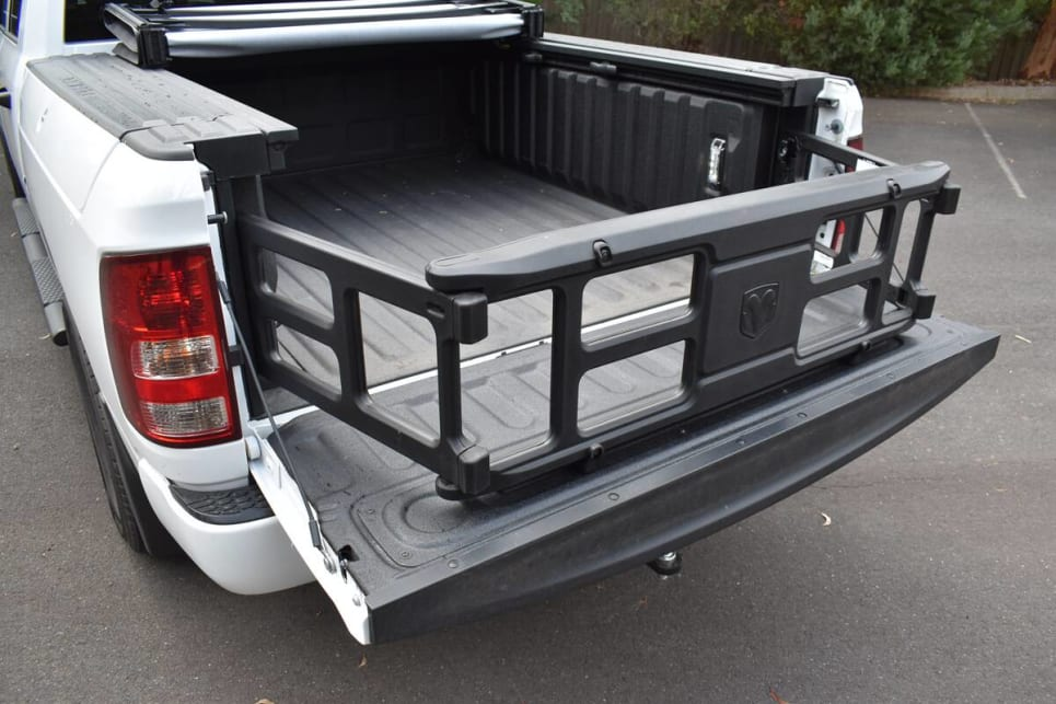 The folding frame can serve as a load divider or can be used to extend the load space.