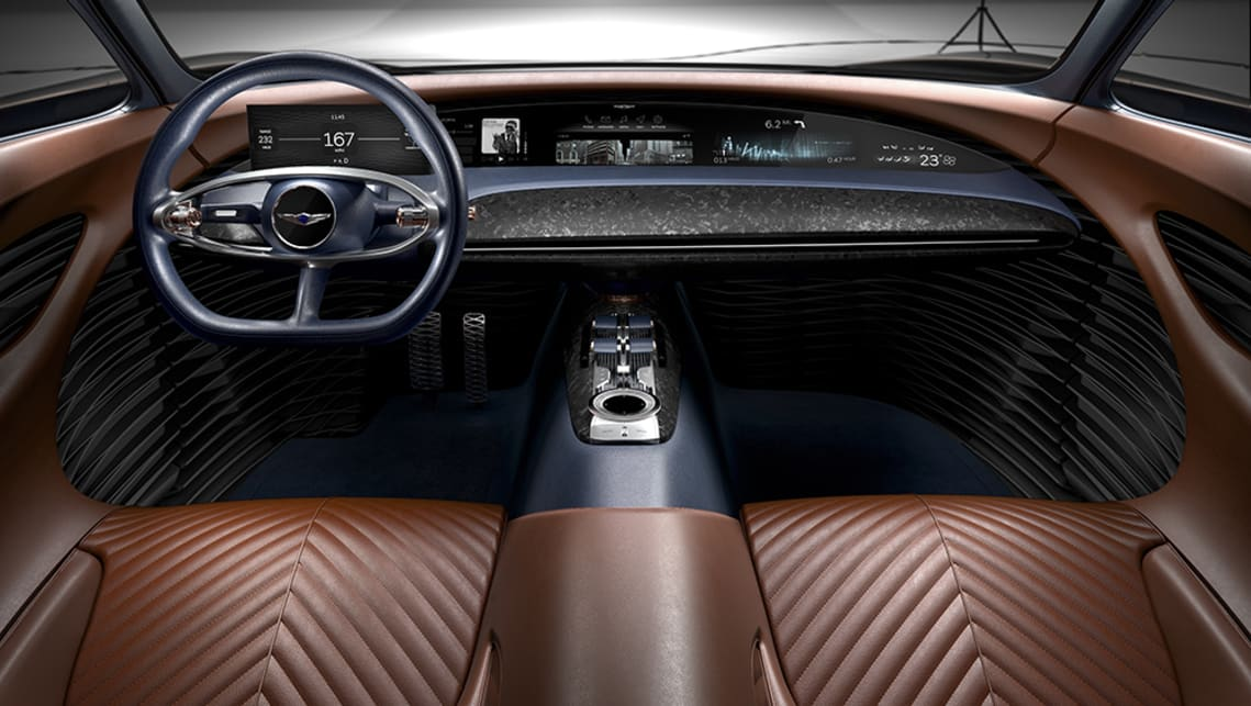 A leather-wrapped centre console neatly splits the cabin in two.