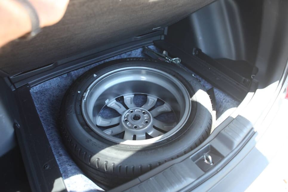 Underneath the boot floor is a full-sized spare.