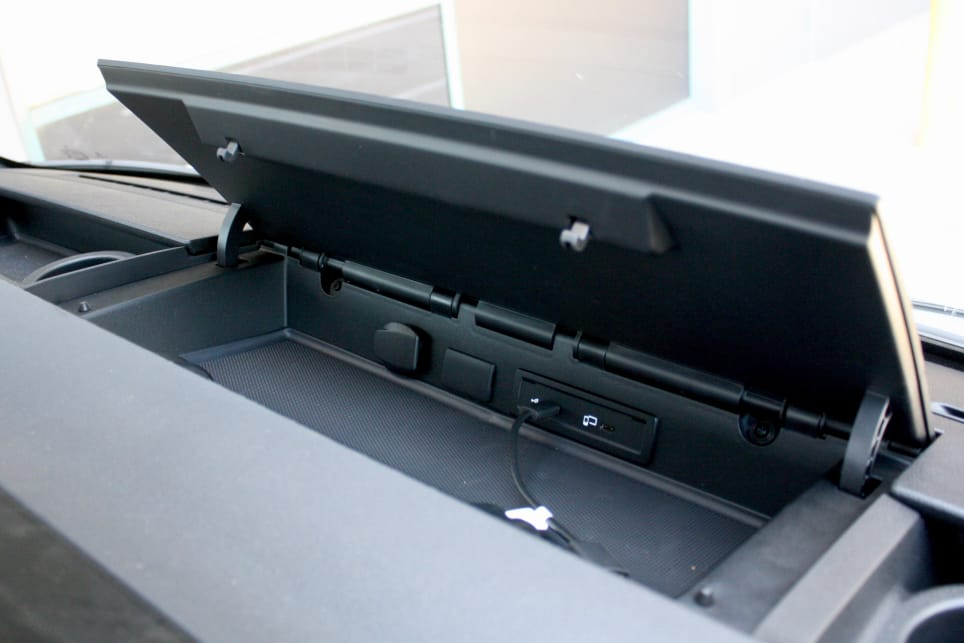 ... a loose-item storage across the top of the driver's dash, and a covered middle bin with twin USB-C ports.
