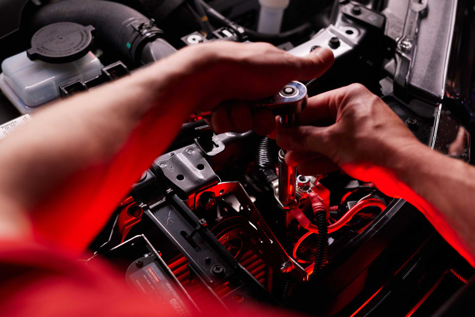 This Redarc BCDC1225D unit is being installed in a HiLux's engine bay. (image credit: Redarc)
