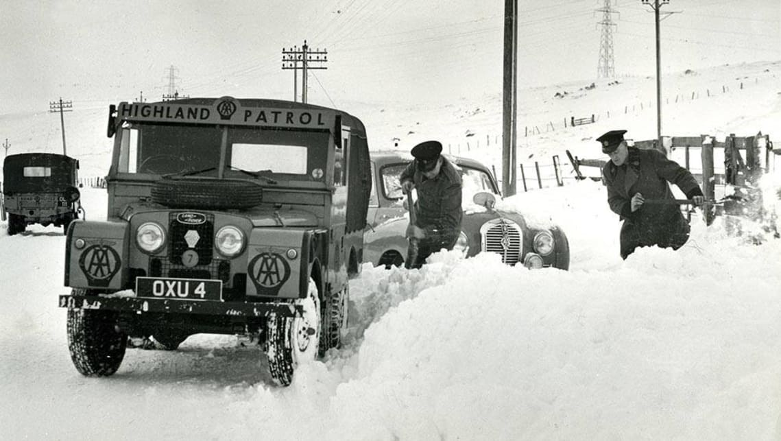 Historic photo of a Land Rover Defender. Highway patrol in the Scottish Highlands.