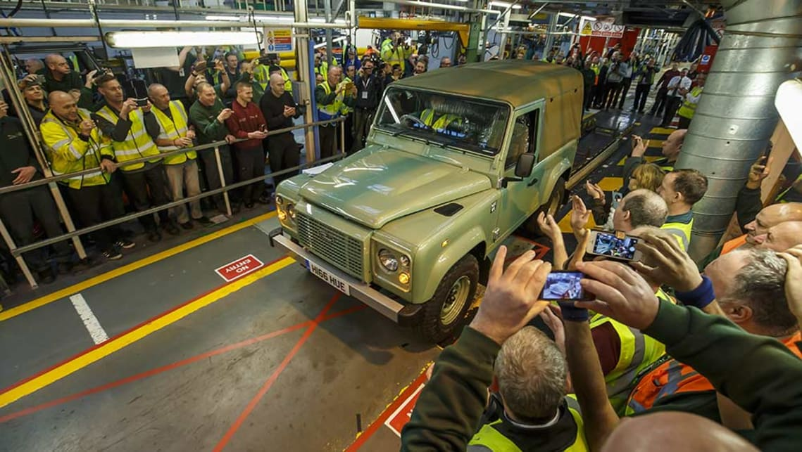 The final Land Rover Defender rolls off the production line.