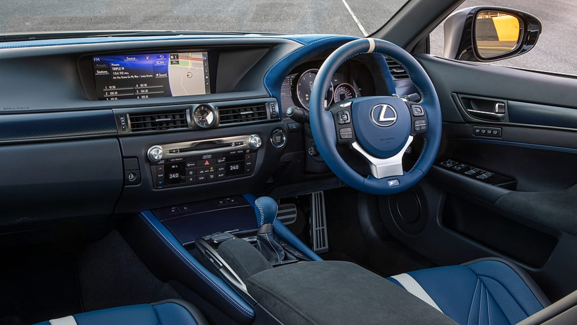 The blue leather continues on the steering wheel, gearshift knob, instrument panel centre console and seatbelts.