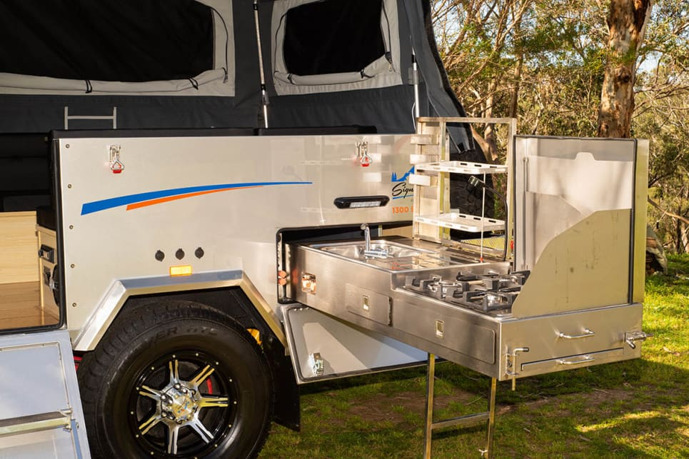 The stainless steel kitchen slides out from the back of the camper.