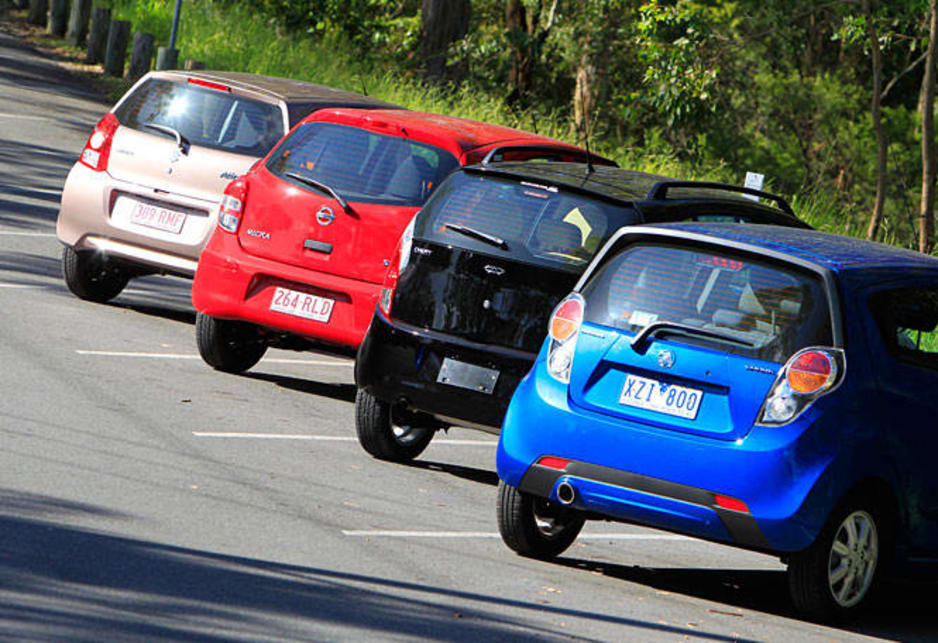 Rear view of the Chery J1, Nissan Micra ST, Barina Spark, and Suzuki Alto GL.