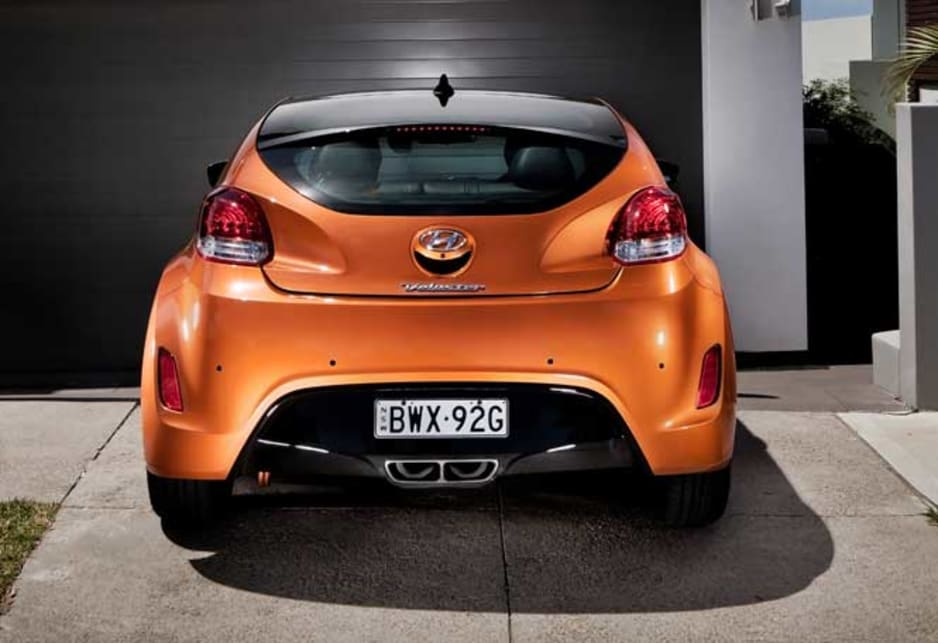 The look from the rear is complex, with a range of geometric shapes including triangles and trapeziums all coming to a focus on low-set centrally situated twin chrome-tipped exhausts. The Veloster cult car gets hot under the lid.