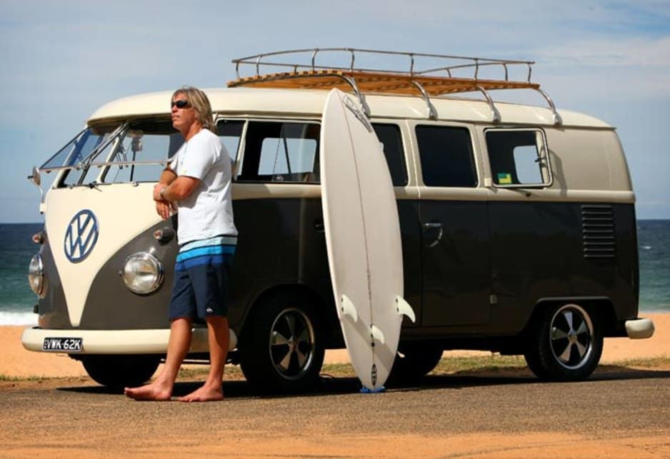No other vehicle looks right with a surfboard. Mick Koeford with his restored 1962 Volkswagen (VW) 'Splitty' Kombi at a beach in Sydney.