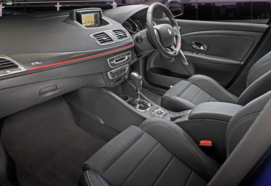 The inside has some obvious shortcomings against its competition - including a marked absence of cupholders. Renault Megane GT Line hatch pictured.