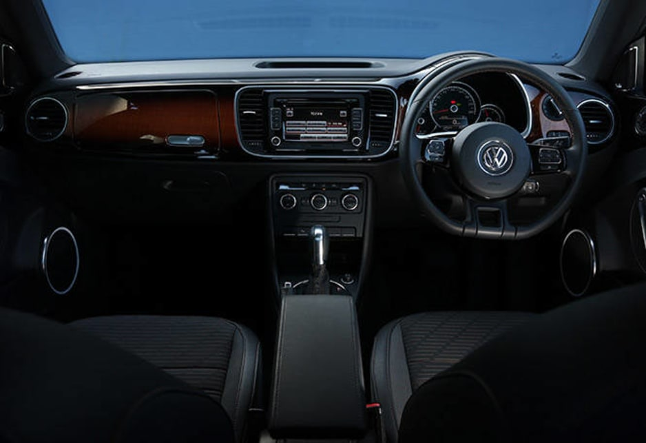Within it's hard (for me at least) not to love the sunburst dashboard fascia just like a Fender. The flat bottomed wheel is another GTI nod, handsomely set in the brown decorative stitching that also adorns the handbrake lever, gearshift, leather surrounded seats and carpet floor mats.