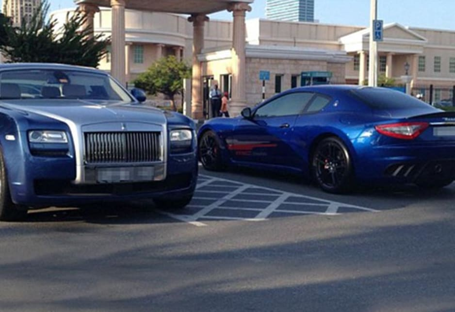 Rolls Royce Ghost rubs shoulders with a Maserati Gran Turismo MC Stradale in the carpark of the American University of Dubai. Image credit: Meeka Nasser