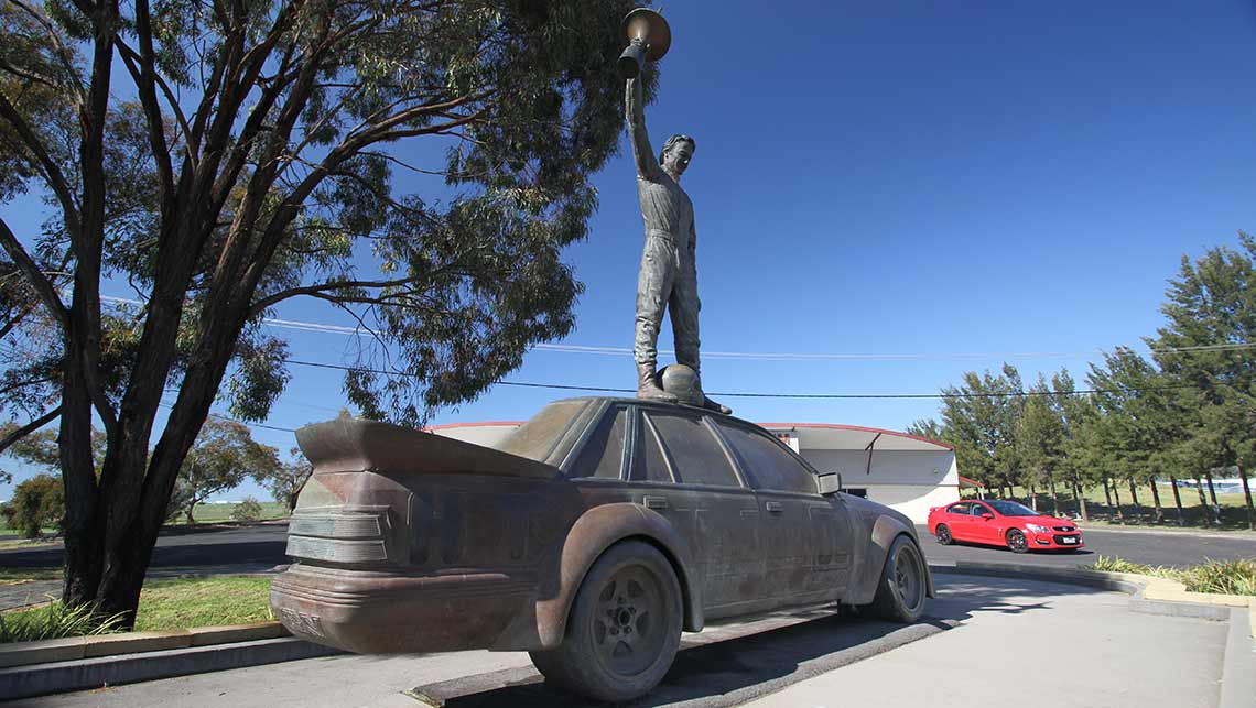 2015 VF Series II Holden Commodore SS-V Redline sedan with the Peter Brock memorial statue at Mount Panorama, Bathurst. Photo credit: Joshua Dowling