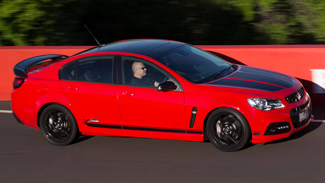 The limited edition Craig Lowndes SS V Special Edition Commodore being driven around Mount Panorama by Joshua Dowling.