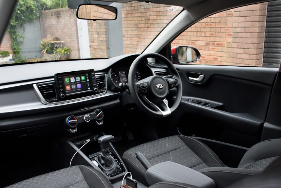 Its plain dashboard is punctuated by a floating touchscreen multimedia system.