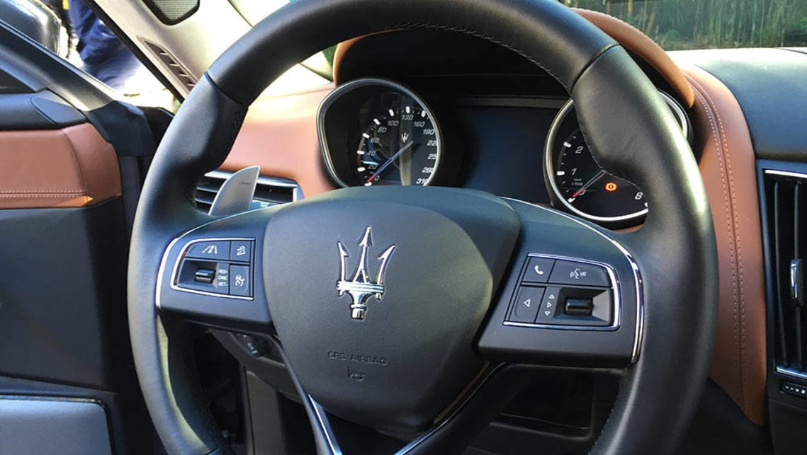 2017 Maserati Levante trident-badged steering wheel.