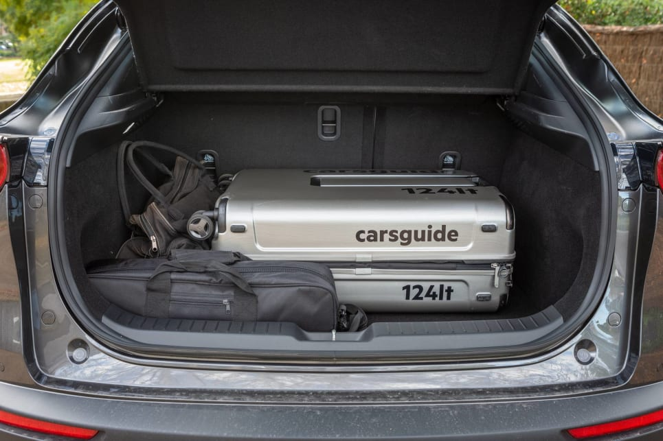 The boot is big enough to fit our largest (124L) CarsGuide travel case, but left little space.