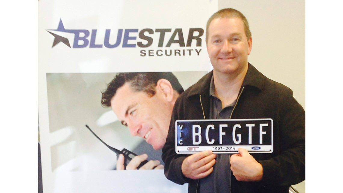Steve Clarke with the number plate he'll use on the last Ford Falcon GT F, with the initials BCF referring to the Breast Cancer Foundation.